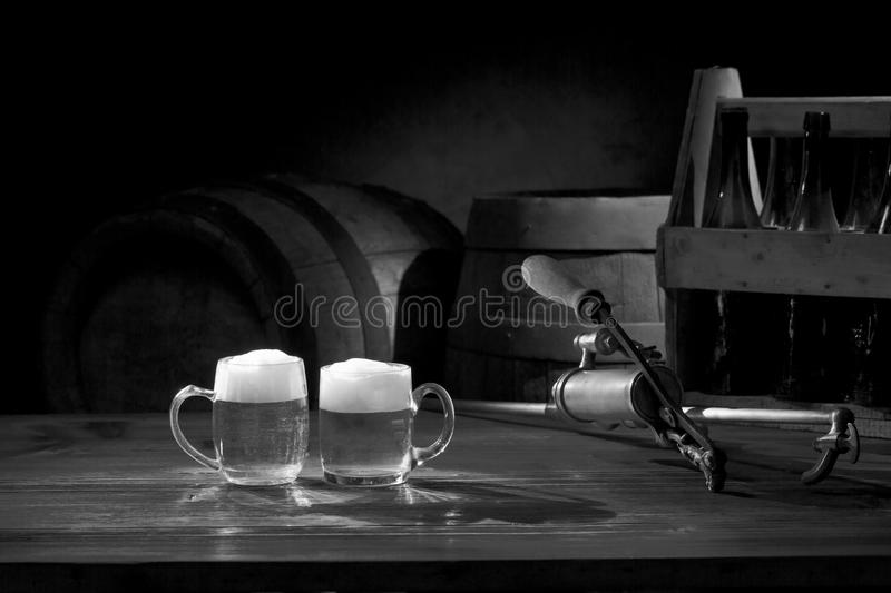 Beer still life on the table with old keg and tap royalty free stock photo