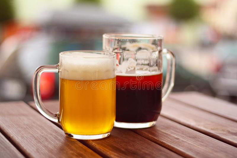 Two glasses of beer on wooden table stock photo