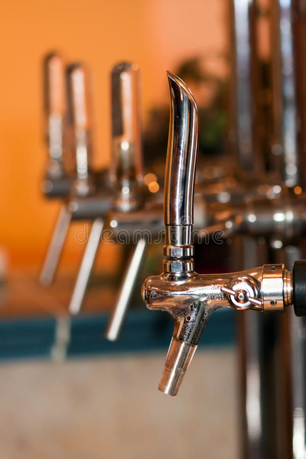 Beer tap. Detail of beer draft tap in a pub royalty free stock photos