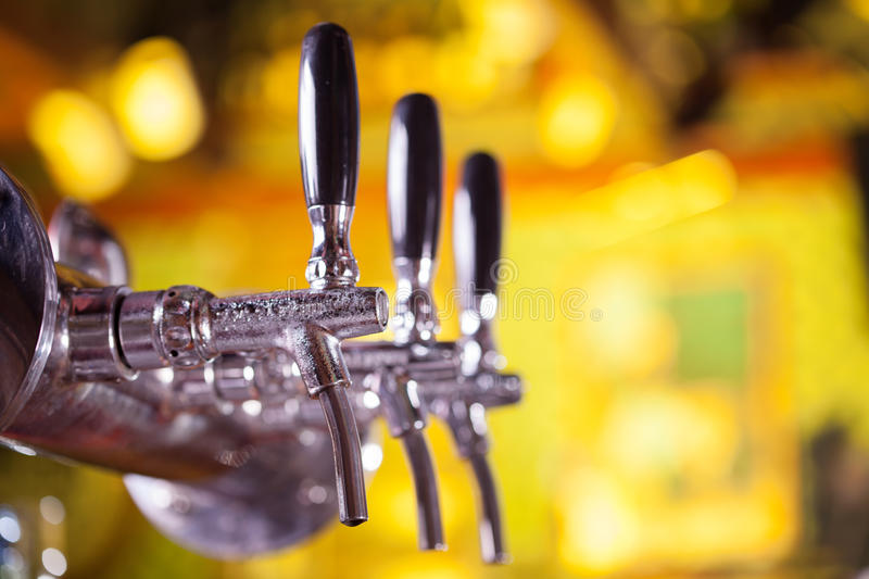 Beer tap. With golden beer-toned background stock photo