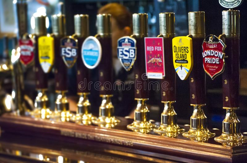 Beer taps in British Pub royalty free stock photo