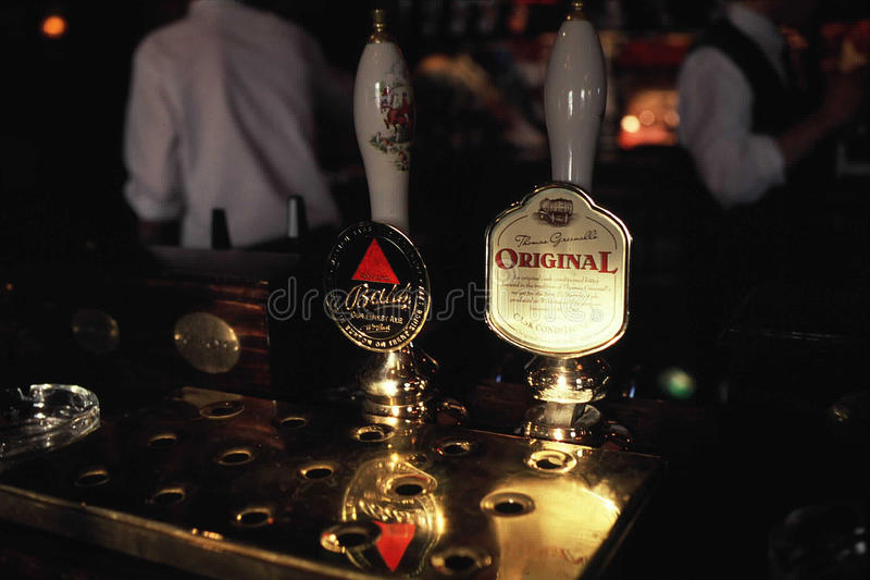 Beer taps in London, England stock photo