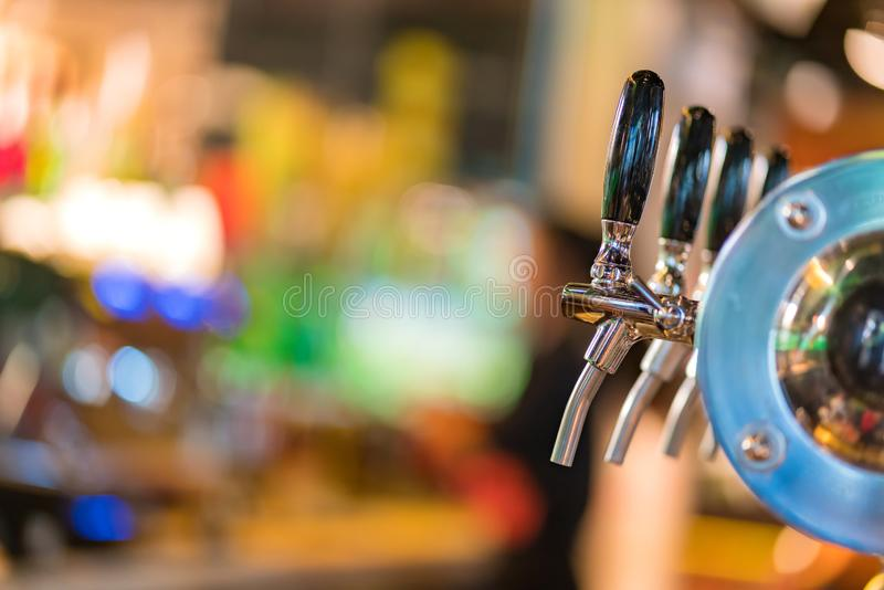 Beer taps in pub or nightclub royalty free stock images