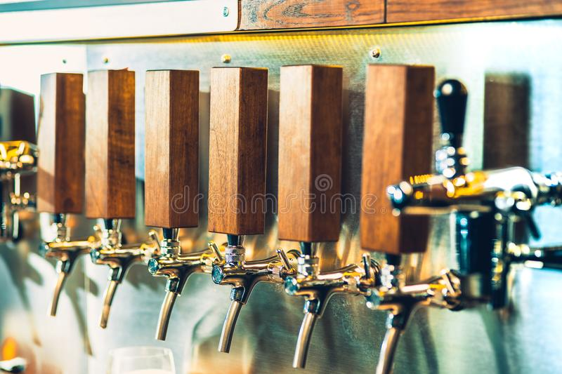 Beer taps in a pub royalty free stock photography