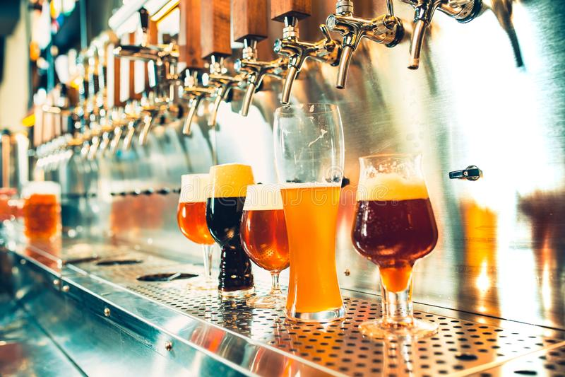 Beer taps in a pub royalty free stock photo
