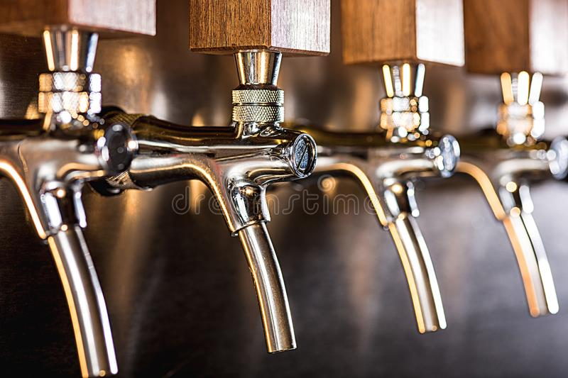 Beer taps in a pub stock photos