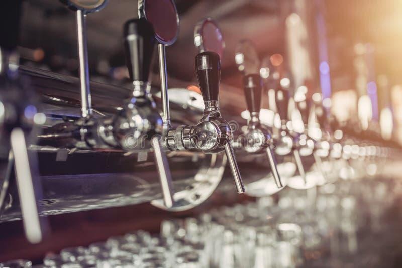 Beer taps in pub stock photos
