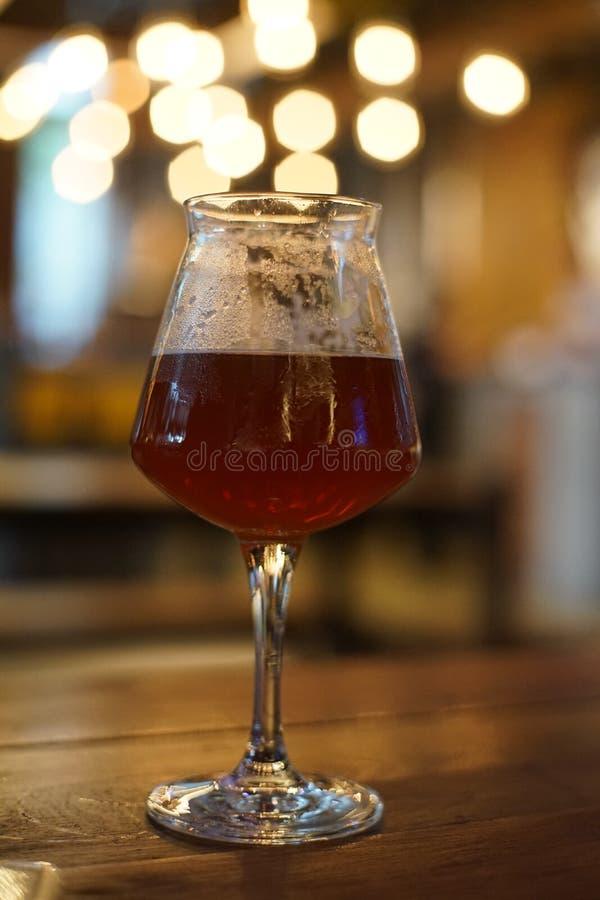 Beer in Teku glass. IPA beer in Teku glass with bokeh royalty free stock images