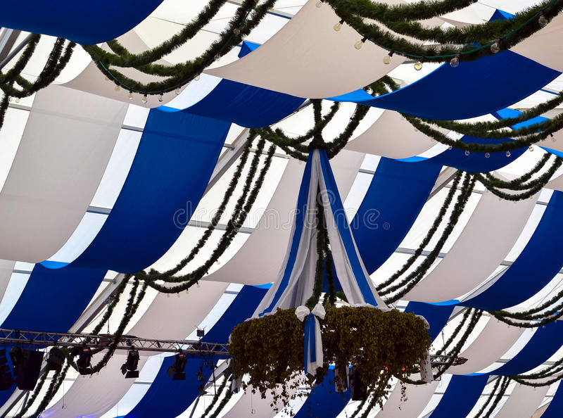 Beer Tent. Blue and white ceiling of a beer tent royalty free stock image