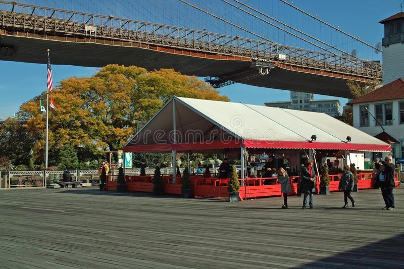 Beer Tent and Ice Cream Factory, Brooklyn New York, USA. A popular destination for tourists, beer tent and ice cream factory on the Fulton Ferry Landing beside royalty free stock image