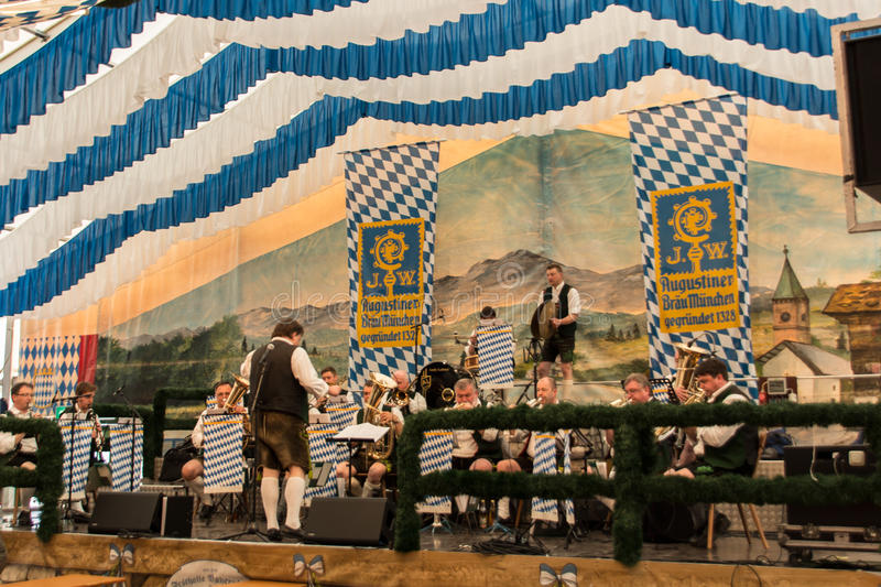 Beer tent at Spring Festival on Theresienwiese in Munich, German. Band making music for the people in the beer tent with traditional bavarian music with brass royalty free stock images
