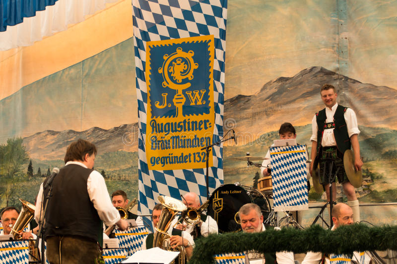 Beer tent at Spring Festival on Theresienwiese in Munich, German. Band making music for the people in the beer tent with traditional bavarian music with brass royalty free stock photos