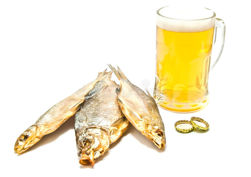 Beer and three salted fishes on white royalty free stock photo