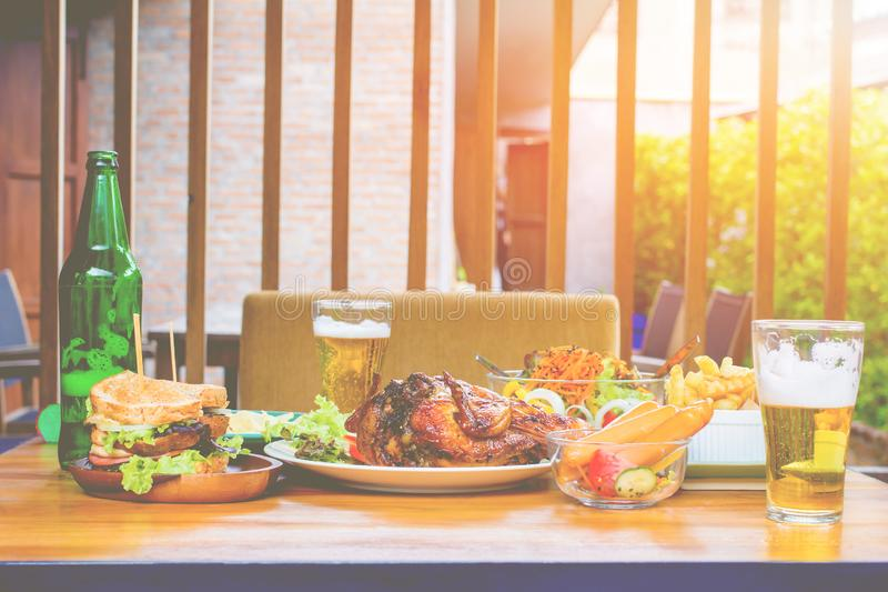 The Beer, turkey, vegetable salad, sandwiches and chips on wooden boards, concepts Holiday food stock photography