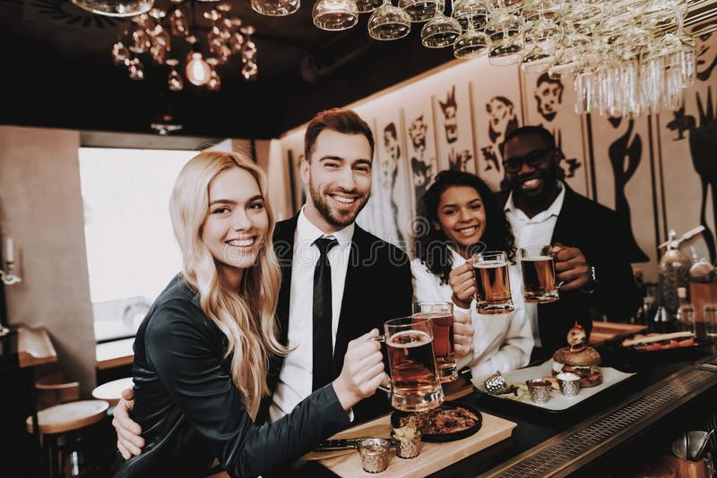 Beer. Two Guys. Girls. Drink Alcoholic Beverages. Beer. Two Guys Girls. Bar. Drink Alcoholic Beverages. Different Races Communicate Young People Rest Have Fun royalty free stock photos