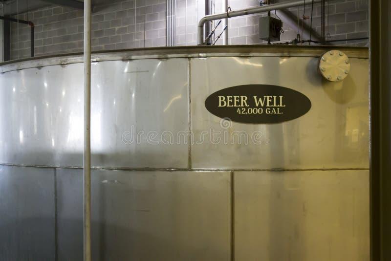 Beer well in distillery. Large metal beer well for distillers beer inside bourbon distillery stock image