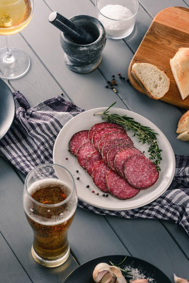 Beer, wine, salami slices royalty free stock photography