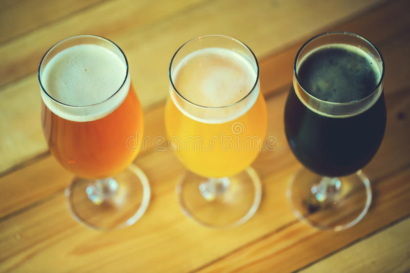 Beer on the wooden table in the pub with free space for your text royalty free stock photo