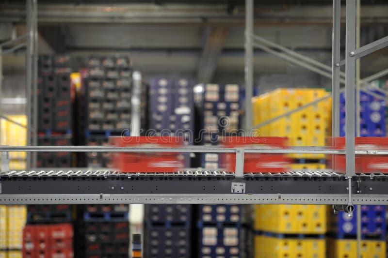Beerbottele crates passing on a conveyor belt