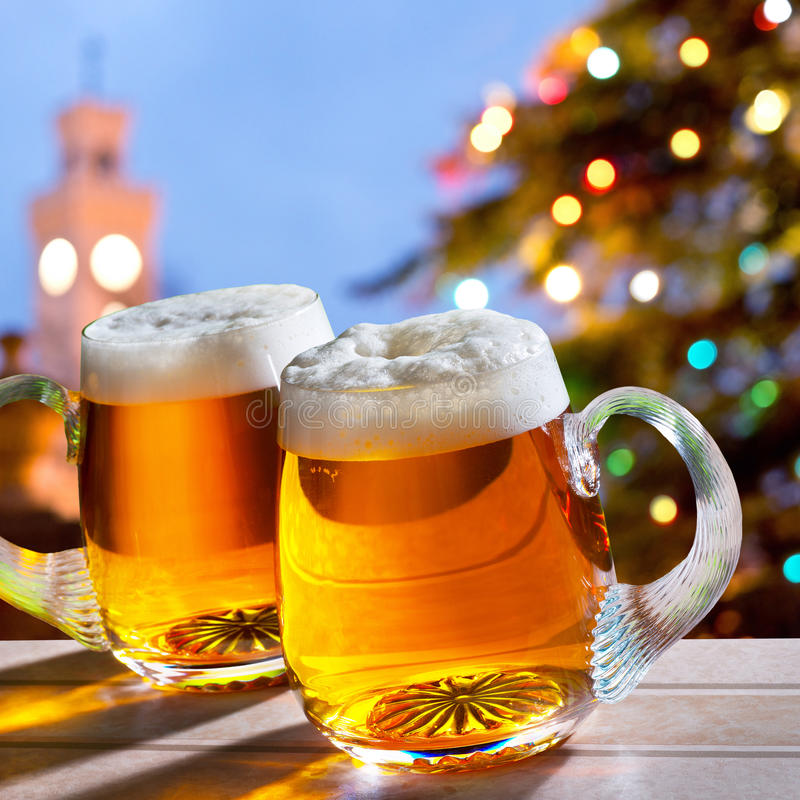 Beers and Christmas tree. Two beer glasses with colored Christmas tree royalty free stock images