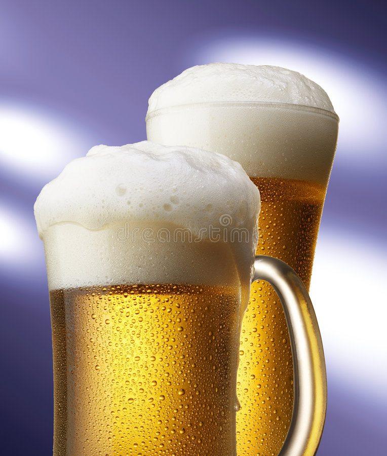 Beers in mug and glass royalty free stock photography