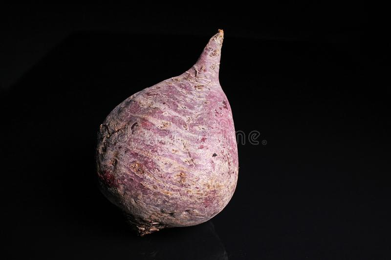 Beet beetroot. Whole and half cutted beet beetroot on black reflective studio background. Isolated black shiny mirror mirrored bac. Kground for every concept royalty free stock images
