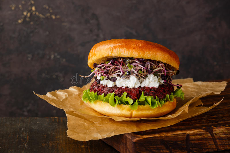 Beet burger with soft cheese and radish sprouts stock photo