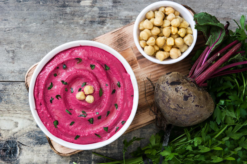Beet hummus in a bowl stock photography