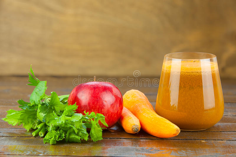 Beet juice in glass on table. Beet juice in glass on wooden table stock image