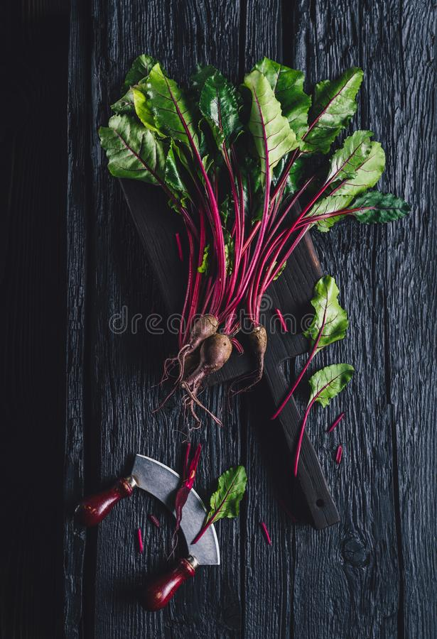 Beet leaves on the black table. stock photo