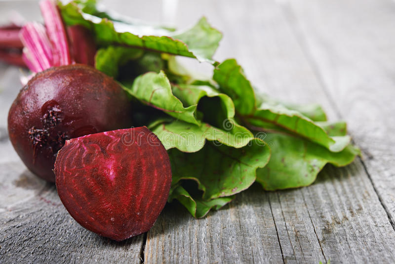 Beet roots and green leaves royalty free stock photo