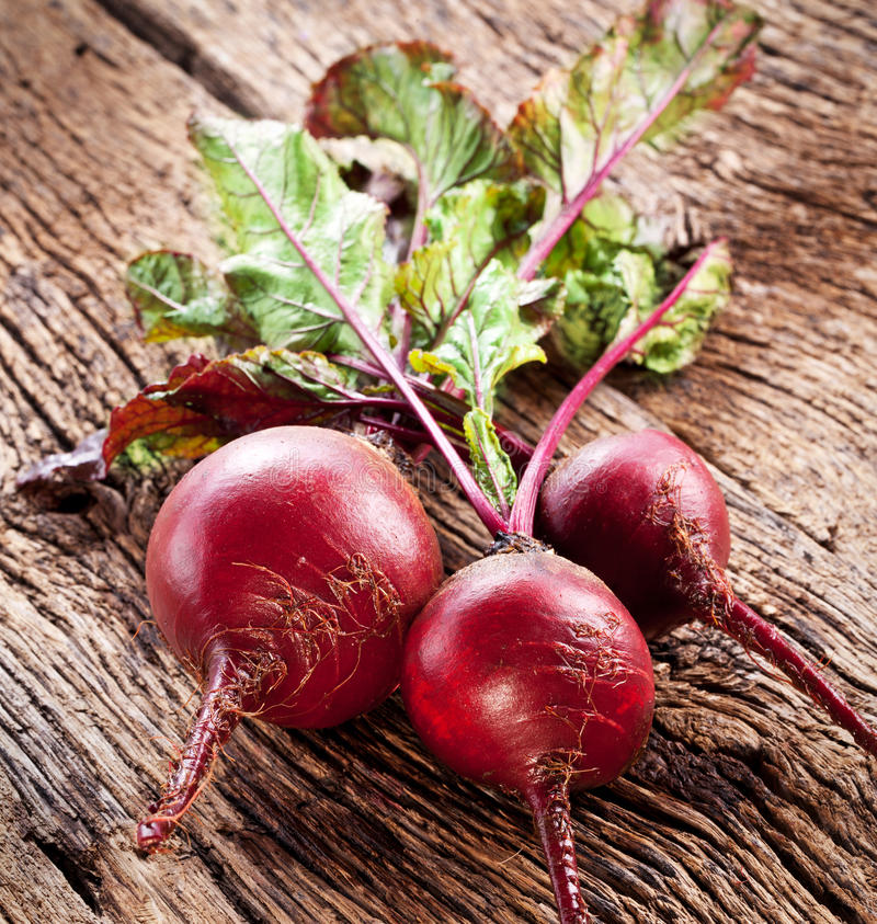 Beet roots. Beet roots on a old wooden table stock photos