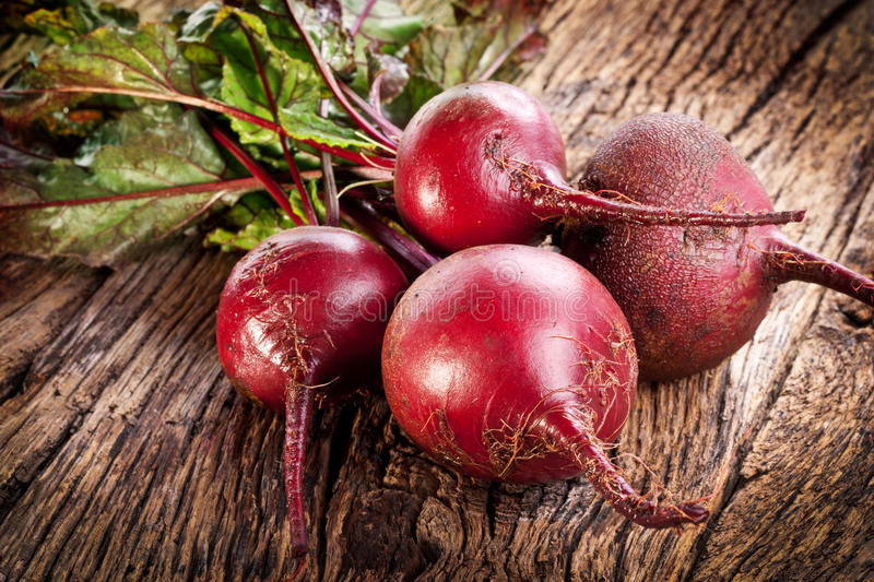 Beet roots. Beet roots on a old wooden table stock image