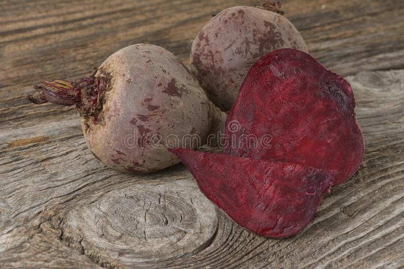 Beet roots. On a old wooden table royalty free stock photos