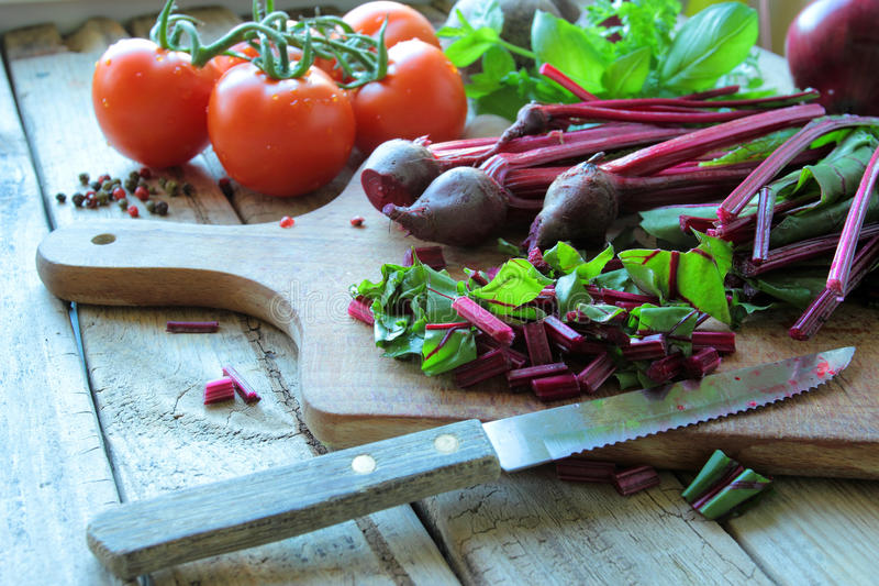 Beet roots on wooden board stock photos