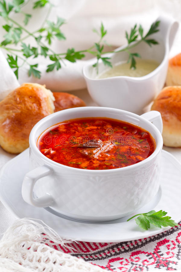 Beet soup with buns and garlic sauce. Russian beet soup with buns and garlic sauce royalty free stock photography