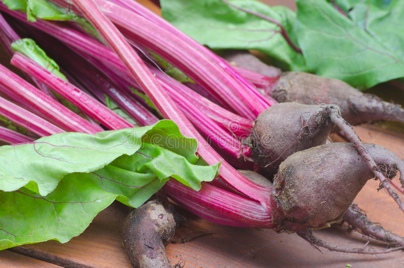Beetroot. Beet roots and leaves on wooden table royalty free stock image
