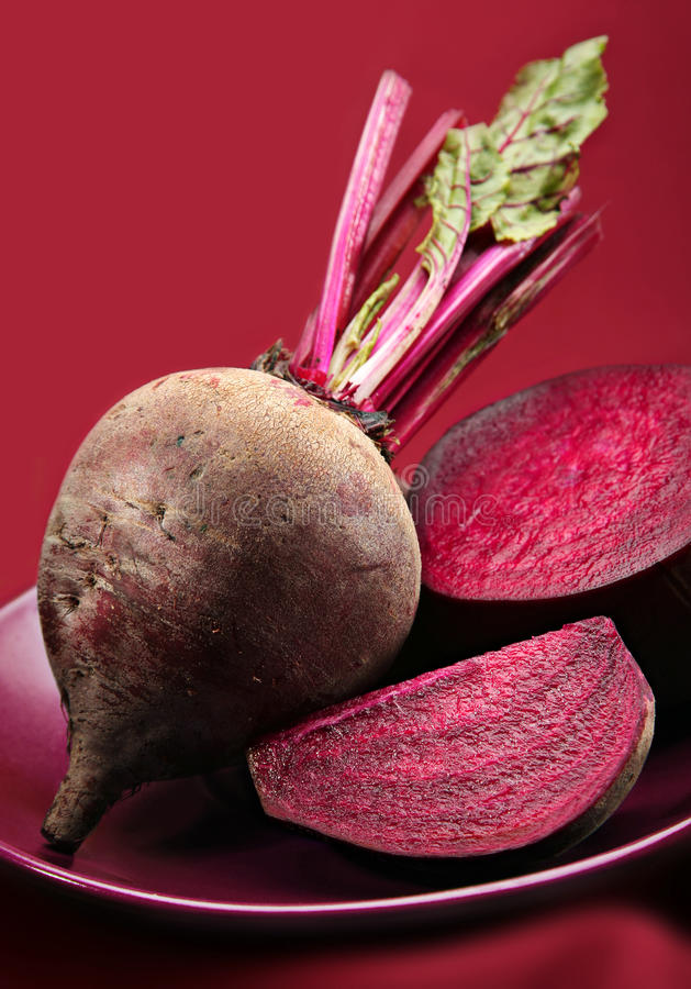 Beetroot detail. Beetroot purple vegetable on purple background royalty free stock photos