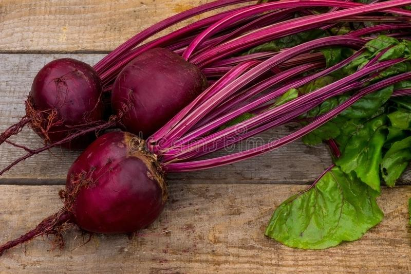 Beetroot from a garden with leaves and roots. Beet from a farm with a garden with leaves and roots royalty free stock image