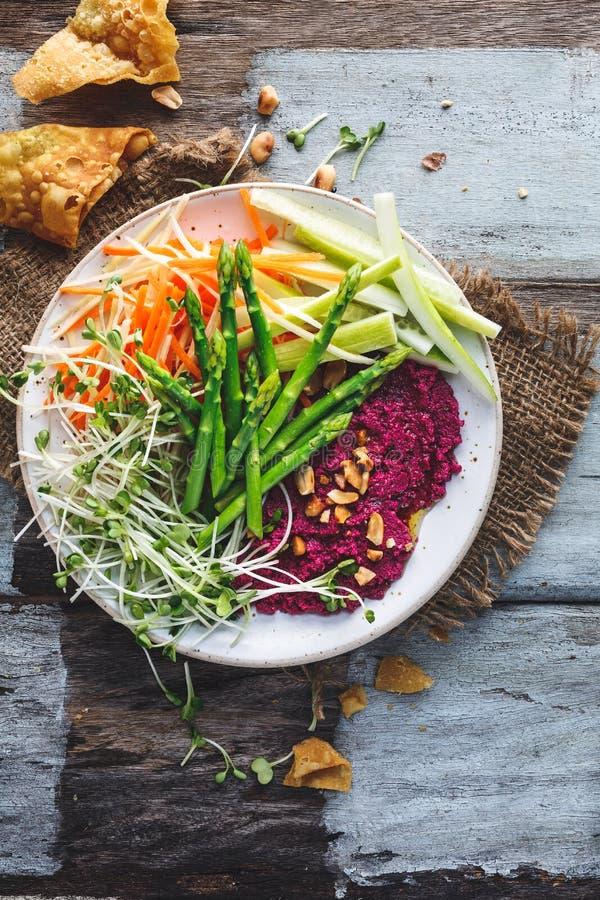 Beetroot Hummus Salad with Asparagus, Carrots, Cucumber. Vegan Salad royalty free stock photos