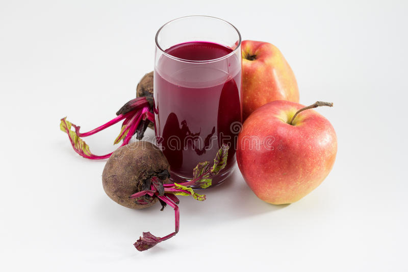 Beetroot Juice. Beetroot, apples and beetroot juice royalty free stock photo