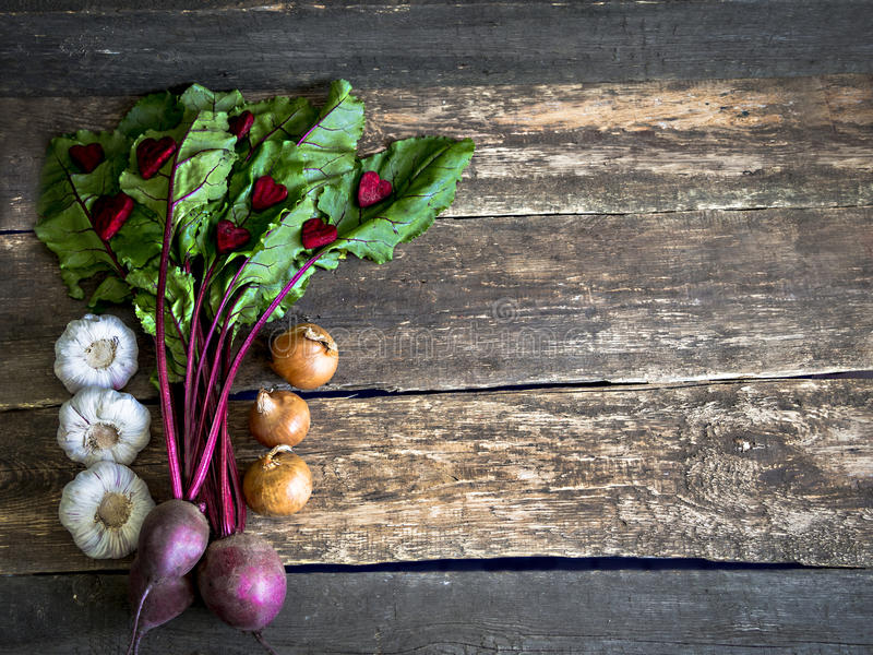 Beetroot onion garlic heart on wooden table, closeup royalty free stock photo