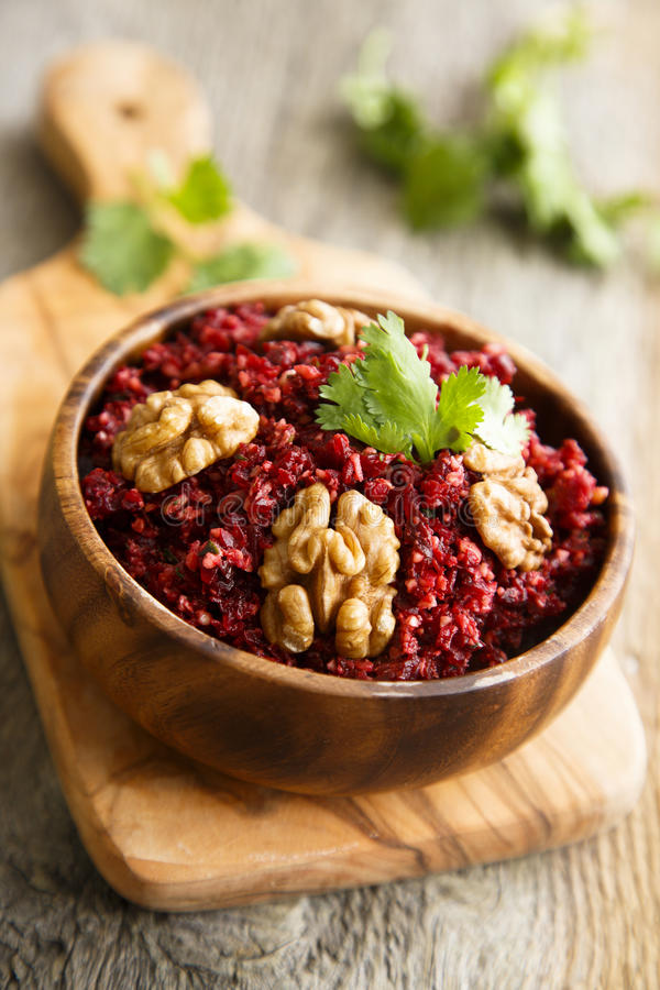 Beetroot relish. With nuts and herbs stock image