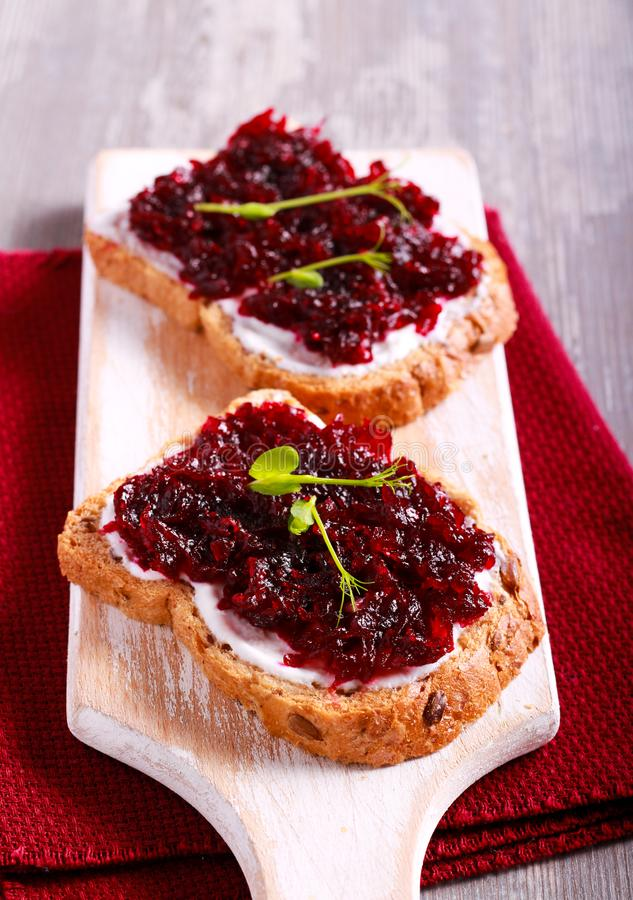 Beetroot relish over brown bread royalty free stock photography