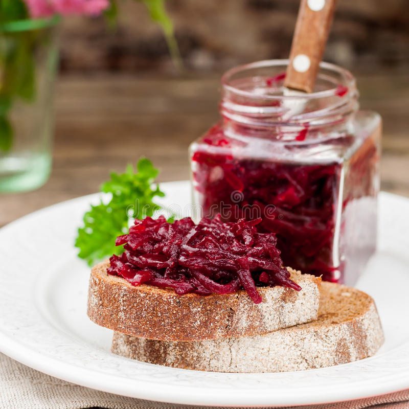 Beetroot Relish Preserves on Rye Toast. Marinated Beetroot Relish Preserves on Rye Toast, square royalty free stock photography