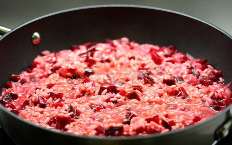 Beetroot Risotto in Pan Close-up stock images