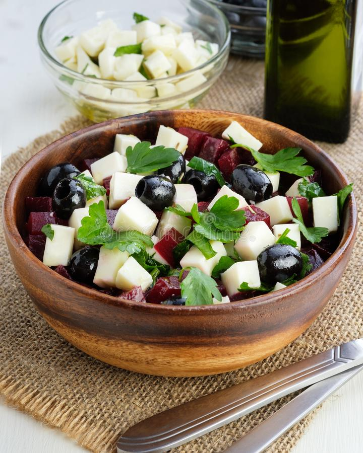 Beetroot salad, feta cheese, olives and olive oil, fresh, vegetarianism royalty free stock image