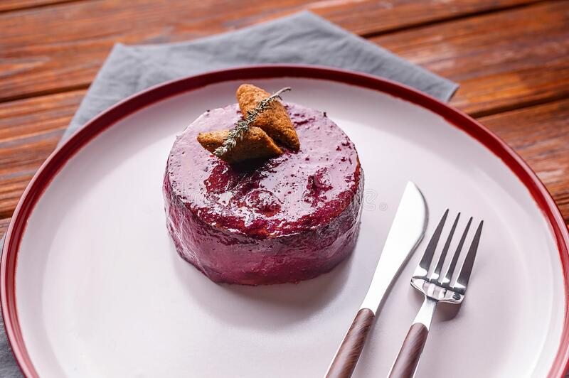 Beetroot salad. Vegetable salad with carrots, potatoes and beetroot mousse. Healthy and diet food stock photos