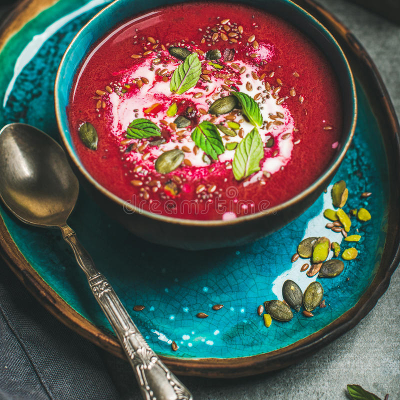 Beetroot soup with mint, chia, flax, pumpkin seeds, square crop stock image