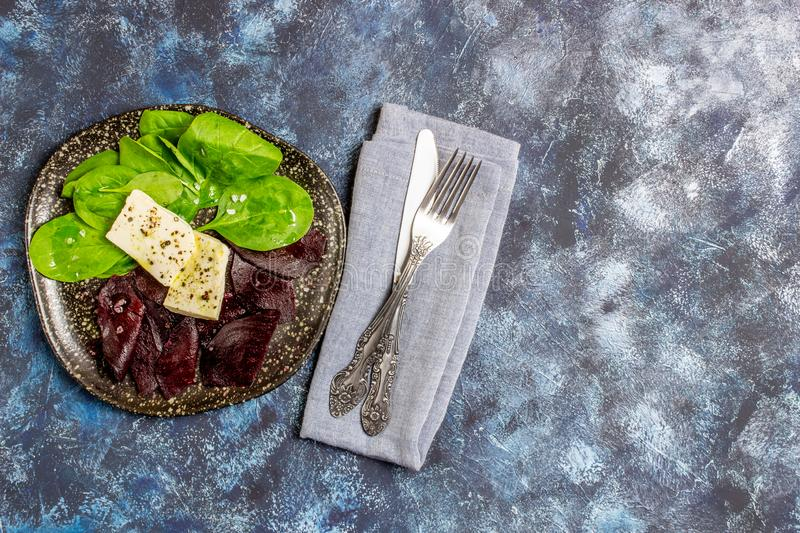 Beetroot, spinach and cheese salad. Healthy eating. Vegetarian food stock image